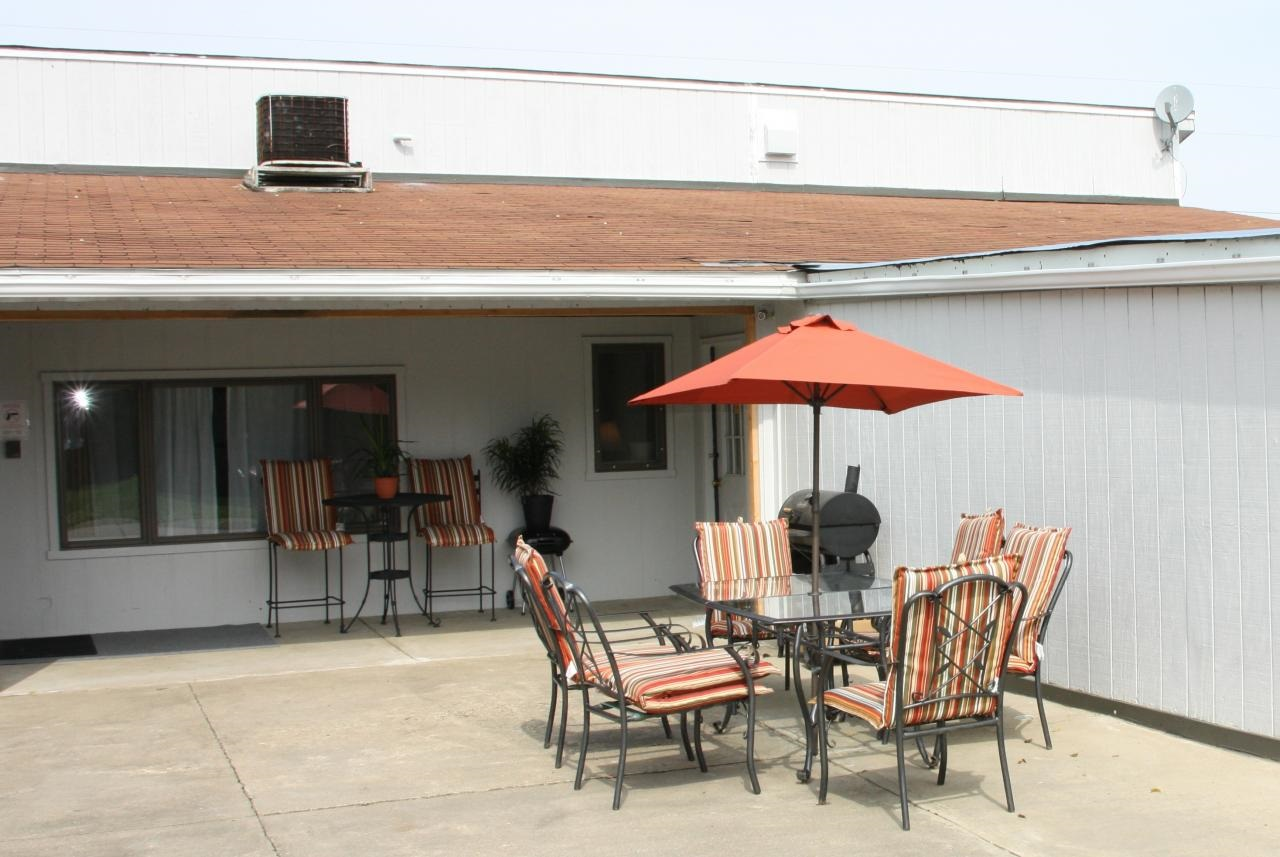 porch with grill and table