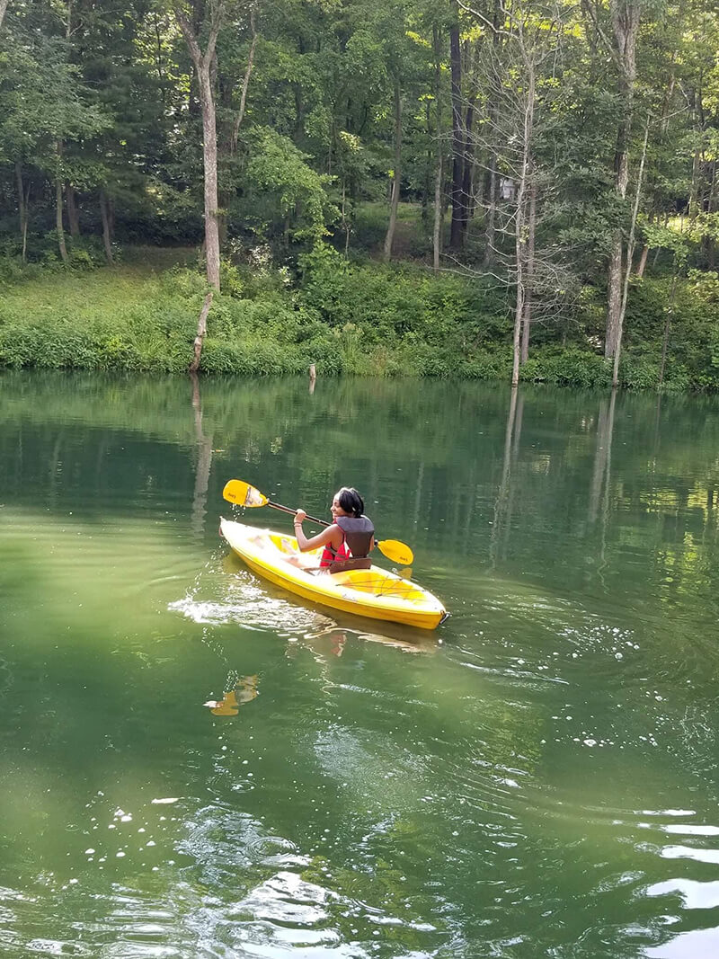 girl smiling and canoeing